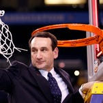 Duke head coach Mike Krzyzewski cuts down the net after his team won the national championship over Butler. Duke defeated Butler, 61-59, at Lucas Oil Stadium in Indianapolis, Ind.