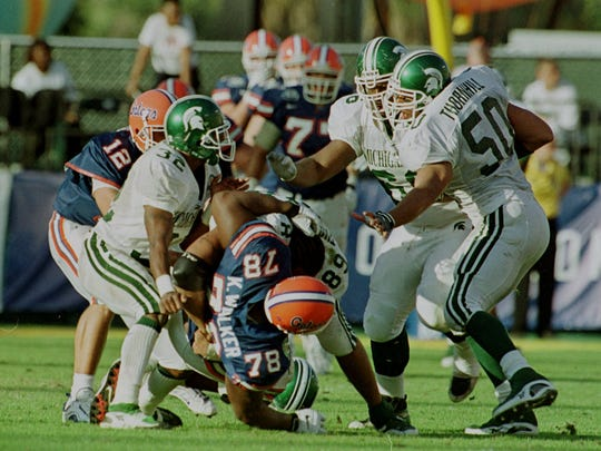 Florida's offense gets into a fight with Michigan State's defense in the third quarter of the Citrus Bowl in Orlando, Fla. Saturday Jan. 1, 2000. Involved in the skirmish is Florida's Doug Johnson, 12, Kenyatta Walker, 78, and Michigan State's Brian Grant, 50, Richard Newsome, 32, Hubert Thompson, 89, and Desmond Thomas, 66. The Spartans defeated the Gators 37-34.