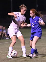 USJ's Abbey Fleming and Jackson Christian's Catie Beth Hatch fight for possession on Monday.