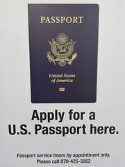 A sign on the door of the Mountain Home Post Office tells customers they must have an appointment to apply for a passport.