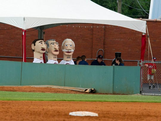 "Mikayla Rowan, left in the Benjamin Bosse head, Kieth Millikan, middle in the William Henry Harrison and Owen Fehr, right wearing the F.J. Reitz head, wait for the ""Evansville Legends"" race during a baseball game at Bosse Field on Saturday, May 19."