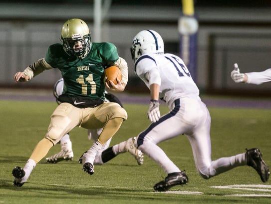 York Catholic quarterback Daniel Yokemick (11) splits