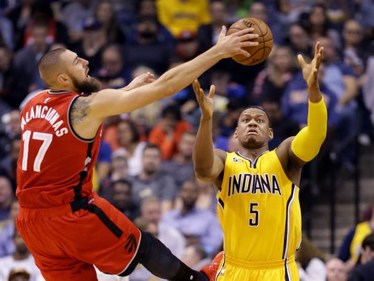 Indiana Pacers forward Lavoy Allen (5) fights for a