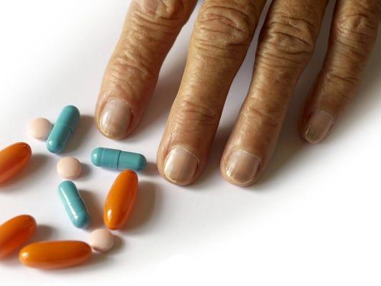 635702486550600388-pills