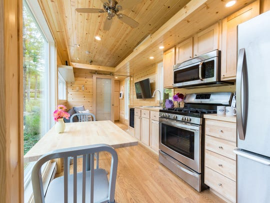 Big windows and kitchen appliances are standard features.