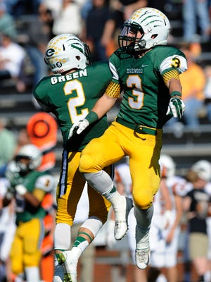 Edgewood's Jackson Tate (3) celebrates with Daniel Green (2) after a Tate touchdown against Marengo Academy in the Class AA AISA State Championship game in Troy, Ala. on Friday November 21, 2014.