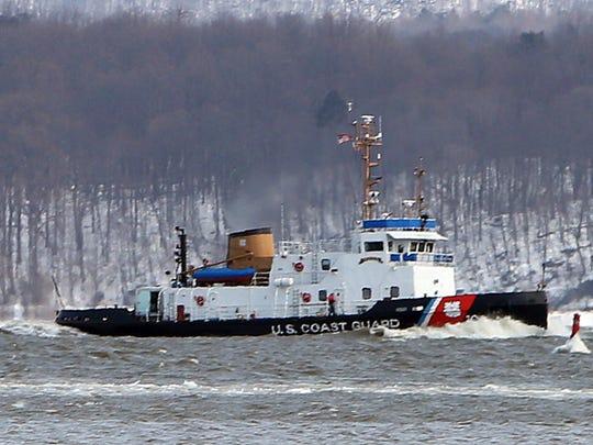 A U.S. Coast Guard icebreaker passes by as U.S. Sen.