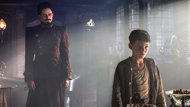 """Hugh Jackman and Levi Miller appear in a scene from the motion picture """"Pan."""""""