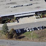 A threat Wednesday, Oct. 1, 2014, led to the evacuation of the new Sandy Hook Elementary School in Monroe. The superintendent's office said the students were being moved to a nearby school where they could be picked up by their parents.