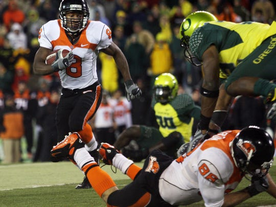 James Rodgers rounds the corner on the game's winning touchdown. In an overtime thriller, Oregon State defeats Oregon 38-31 in the 111th Civil War football game at Autzen Stadium in Eugene, Dec. 1, 2007. THOMAS PATTERSON | Statesman Journal