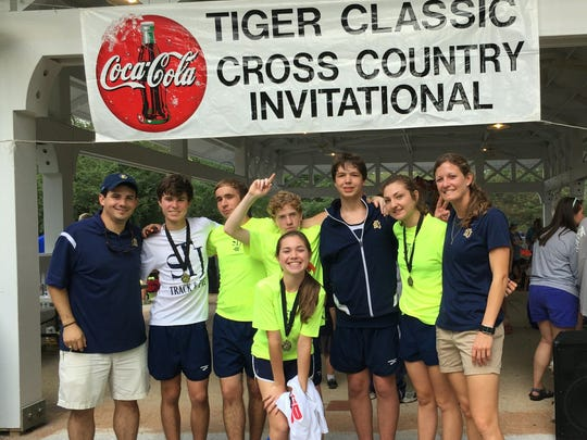Coaches Jessica Owens and Chris Campos with members of the STJ Cross Country team at the Tiger Classic in Auburn.