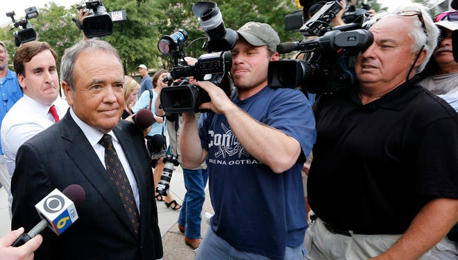 Surrounded by reporters, former Star Scientific CEO Jonnie Williams leaves the federal courthouse July 31, 2014, in Richmond, Va., after testifying in the federal corruption trial of former Virginia Gov. Bob McDonnell and his wife.