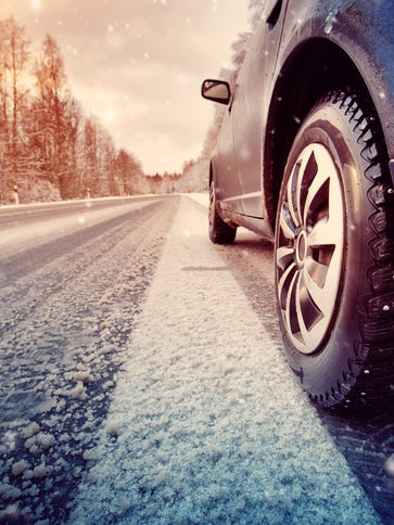A stock photo of a vehicle driving on a snow-covered