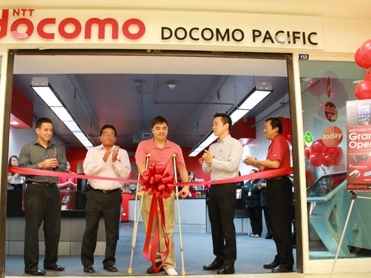 DOCOMO PACIFIC held a ribbon-cutting ceremony for their new store inside the Agana Shopping Center on June 29. From left, Charles McJohn II, marketing manager, Agana Shopping Center; Vince Mafnas, director of sales, and Tom Valderrama, chief commercial officer, both of DOCOMO PACIFIC; Eric Uy, assistant general manager, Agana Shopping Center; and John Woo, chief network officer of DOCOMO PACIFIC.