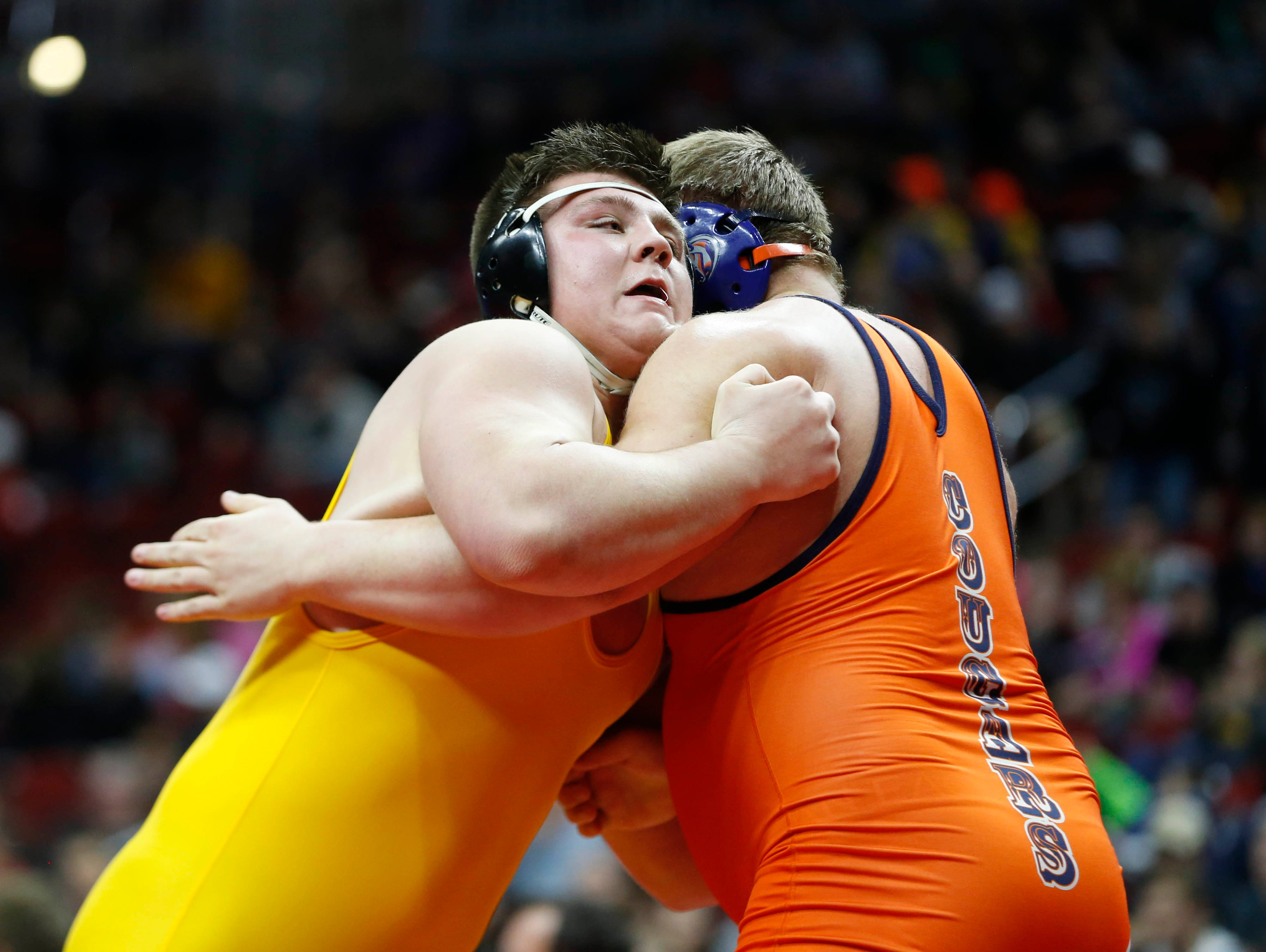 Manson Northwest's Tim Butcher (right) wrestles Regina's Jared Brinkman Saturday, Feb. 20, 2016 during the class 1A state wrestling tournament finals in Des Moines.