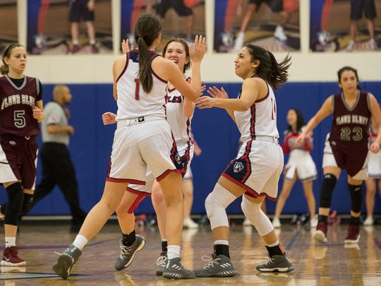 Players celebrate with Veterans Memorial's Victoria Arismendi after her last second basket to defeat Flour Bluff 34-33 at Veterans Memorial on Wednesday, Jan. 17, 2018.