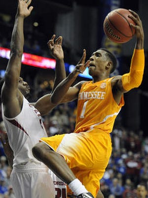 Josh Richardson, right, a former Tennessee guard, was drafted by the Miami Heat in the second round of Thursday night's NBA Draft.