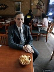 Rabbi Mathew Hoffman of New Rochelle sits in Eden Wok