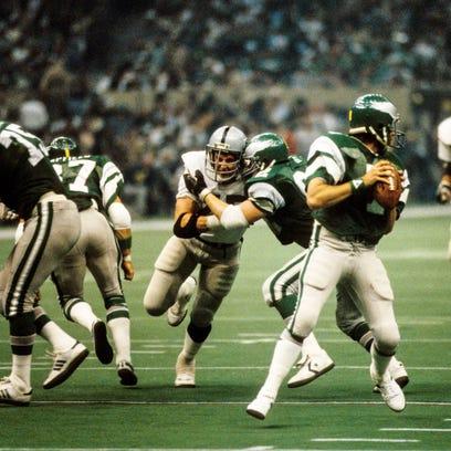 Raiders defensive tackle Joe Campbell (center) pressures