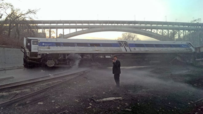 Ryan Kelly, a passenger on the train car pictured, took this photo of the Metro-North Railroad derailment in the Bronx on Dec. 1, 2013. Four people were killed and dozens were injured in the crash.