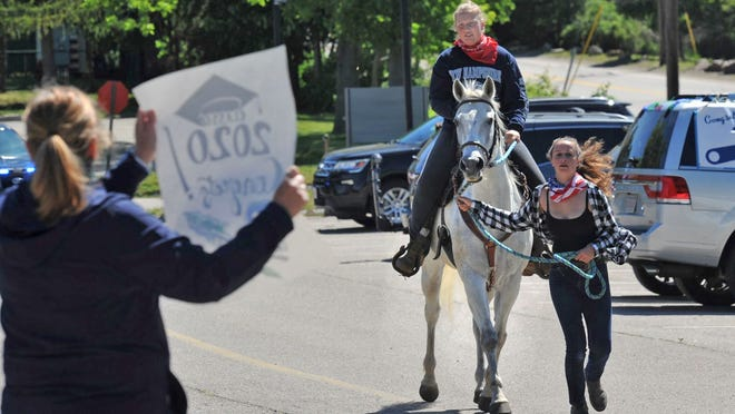 Blue Hills Regional Technical High School graduating senior Savannah Lynch of Holbrook rides her horse Abby during the senior parade around the Canton school bidding farewell to their teachers, Monday, June 1, 2020. Tom Gorman/For The Patriot Ledger