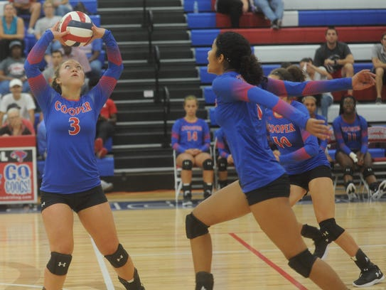Cooper's Pearce Bjorlie, left, sets the ball for a