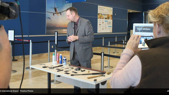 TSA spokesman Mark Howell displays prohibited items left by passengers at the Myrtle Beach International Airport in a photograph posted by the airport on Facebook.