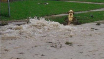 Water floods Redskin Drive after a fire hydrant was struck.