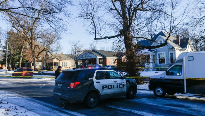 Police investigate the scene of a shooting on the 1400 block of N Clay Avenue on Friday, Jan. 19, 2018.