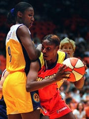 Phoenix Mercury's Toni Foster, right, looks for a way around Los Angeles Sparks' Lisa Leslie during the first half at the Great Western Forum in Inglewood, Calif., Sunday, July 13, 1997. The Mercury won 57-56. (AP Photo/Michael Caulfield)