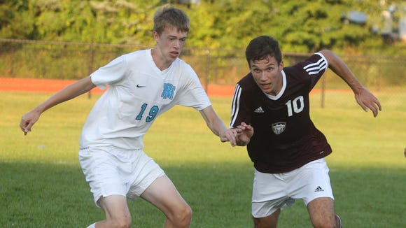Valhalla's Kaio DaSilva, right, is pressured by Rye Neck's Fraser Shaw during their game at Rye Neck on Sept. 17.