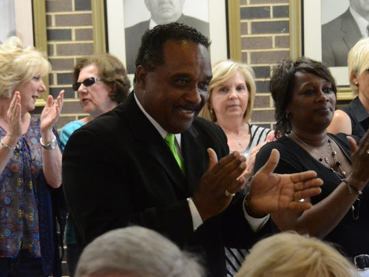 Allen Holmes applauds the declaration of desegregation unitary status achieved by the Avoyelles Parish School Board. Holmes joined the district's desegregation case as an intervenor in 1987. The case originated in 1967. The school board held a special meeting Friday to sign the decree and make the announcement.