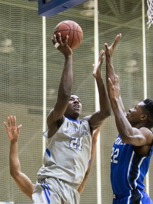 Darryl Tucker (21) shoots over Cedric Guillaume (22) during the men's basketball game against Shorter University at the University of West Florida on Saturday, February 25, 2017.