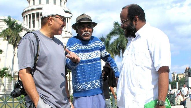 In Havana in 2007, from left, DeWayne Wickham, Cuban retiree Leonides Terrero and Gregory Kane.