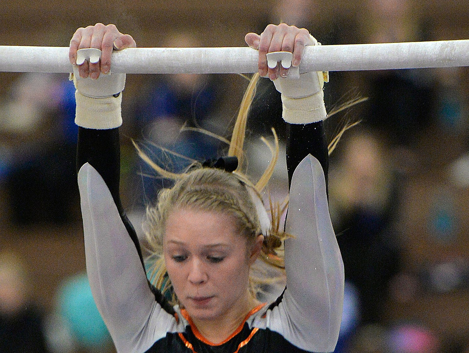 St. Cloud Tech senior gymnast Kalley Thompson swings through her routine on the uneven bars Saturday, Dec. 5 during the St. Cloud Apollo Gymnastics Invite.