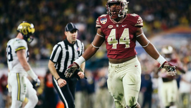 Demarcus Walker (44) celebrates a sack during the first half of the Orange Bowl on Friday, December 30, 2016. The Seminoles topped the Michigan Wolverines 33-32.