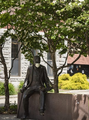 A statue of Sigmund Freud wears a face mask on the Clark University campus on Wednesday.