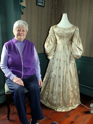 Mary Sawyer's wedding dress is on display at the Sterling Historical Society, where Faythe Palmer, 91, is amon gthe volunteers maintaining the town's historic artifacts.