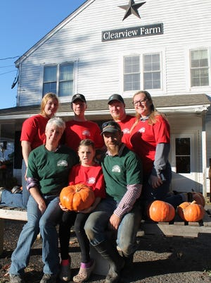 Carrie and Chris McNamara, front, with their children, from left, Bailey, Brady, Dublynn, Keegan and Kiera, at Clearview Farm in Sterling.
