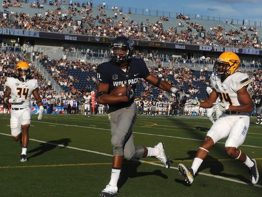 Nevada's Daiyan Henley (11) runs for a touchdown against