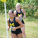 McAuley senior Anna Sontag, front, and junior Emma Fitz pack together at an early season cross country race at National Trails.