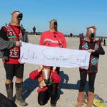 This group was among around 75 people who plunged into the Atlantic Ocean off Assateague, Virginia on New Year's Day during the 5th Annual Polar Pony Plunge, hosted by Chincoteague Christmas by the Sea.