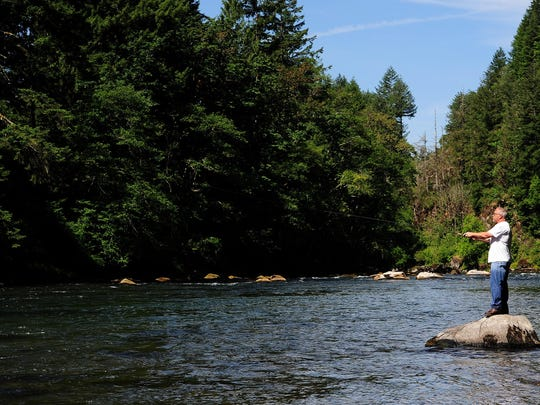 Monte Burke, of Keizer, casts into the Santiam River while fishing at Packsaddle County Park, on Tuesday, June 22, 2015, near Gates, Ore. Afternoon fishing will be closed down on many Oregon rivers beginning Saturday, and will be closed entirely on some streams due to the ongoing drought and high water temperatures.