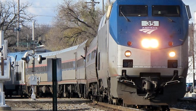 Amtrak is blaming freight operators for long delays on its runs between Washington, D.C., and Chicago, as well as its Michigan trains to Chicago.