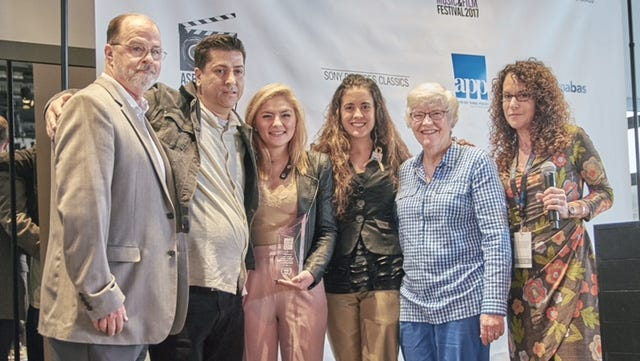 Margaret Fisher, M.D., second from right, medical director of The Unterberg Children's Hospital, presents the RWJBarnabas Health Award to film maker Kostas Lymperopoulos, second from right.