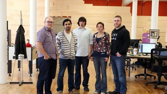Modulus CEO Charlie Key, far left, in the startup's office last summer.