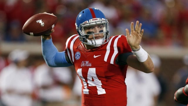 Mississippi quarterback Bo Wallace readies to pass in the first half of an NCAA college football game against Memphis in Oxford, Miss., Saturday, Sept. 27, 2014.  (AP Photo/Rogelio V. Solis)