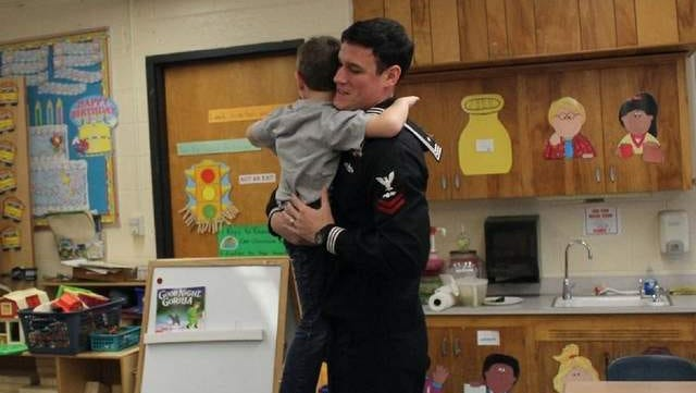 Aviation Electricians Mate 2nd Class Petty Officer Danny Dombrowsky made a surprise visit to younger brother Aidan's kindergarten class at Nellie Bennett Elementary School.