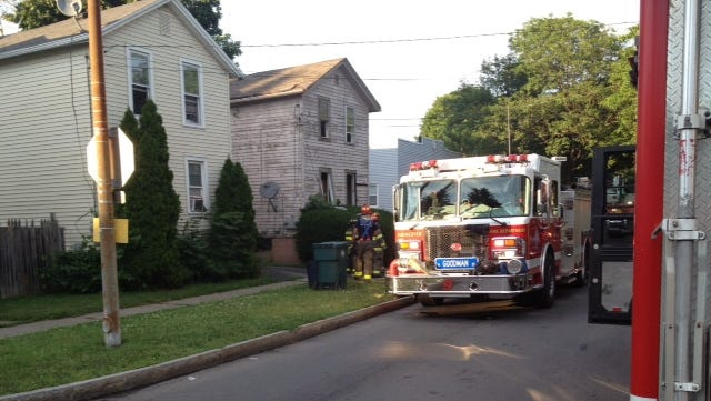 Rochester firefighters at the scene of a fatal fire on Fernwood Avenue on Tuesday.