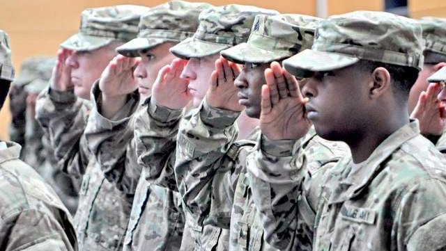 The Army's active component strength is expected to hit 490,000 by Sept. 30, 2015. Here, V Corps soldiers salute during a casing ceremony in Wiesbaden, Germany.